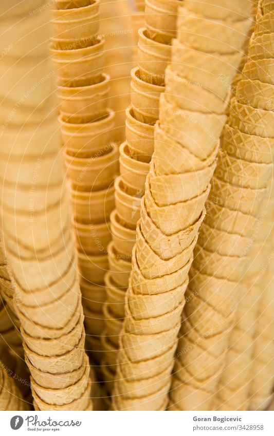 Stack of empty waffle ice cream cones icecream dessert food wafer close background closeup shop sweet delicious crispy group detail tasty sweets stacked many