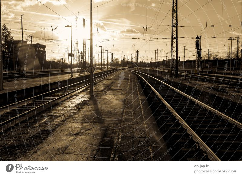 Corona thougths | impossible to escape Track Railway tracks railway tracks rails Switch Platform Overhead line Train station Empty Old voyage corona coronavirus