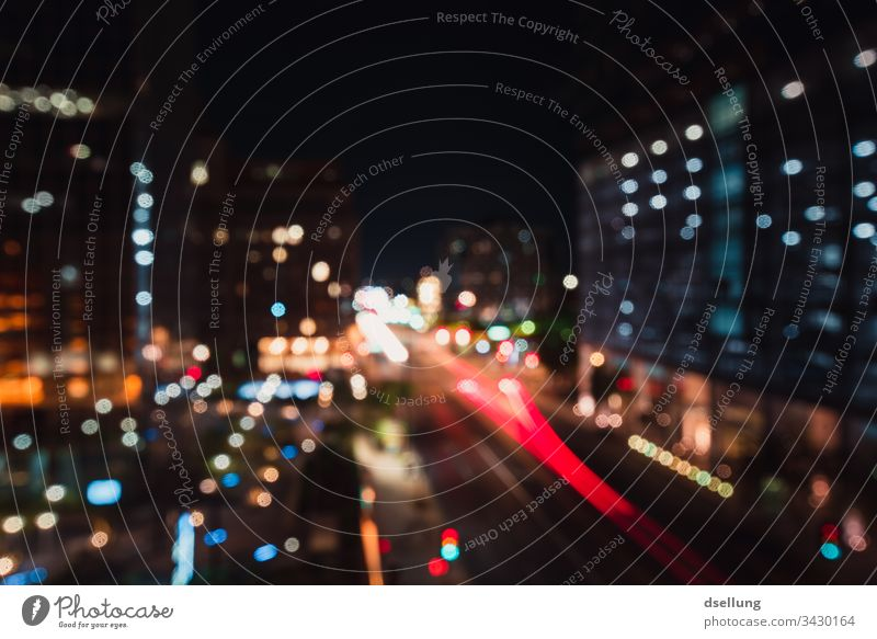 Nightlights in the big city Blur Back-light Light (Natural Phenomenon) Artificial light Deserted Abstract Colour photo Exterior shot Irritation Dream Surrealism