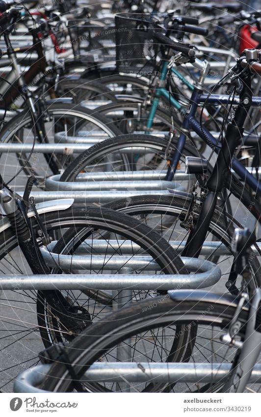 bicycle stand bike bikes cicycles parking rack cycling outdoor public wheel transport sports city urban mass many station environmental detail