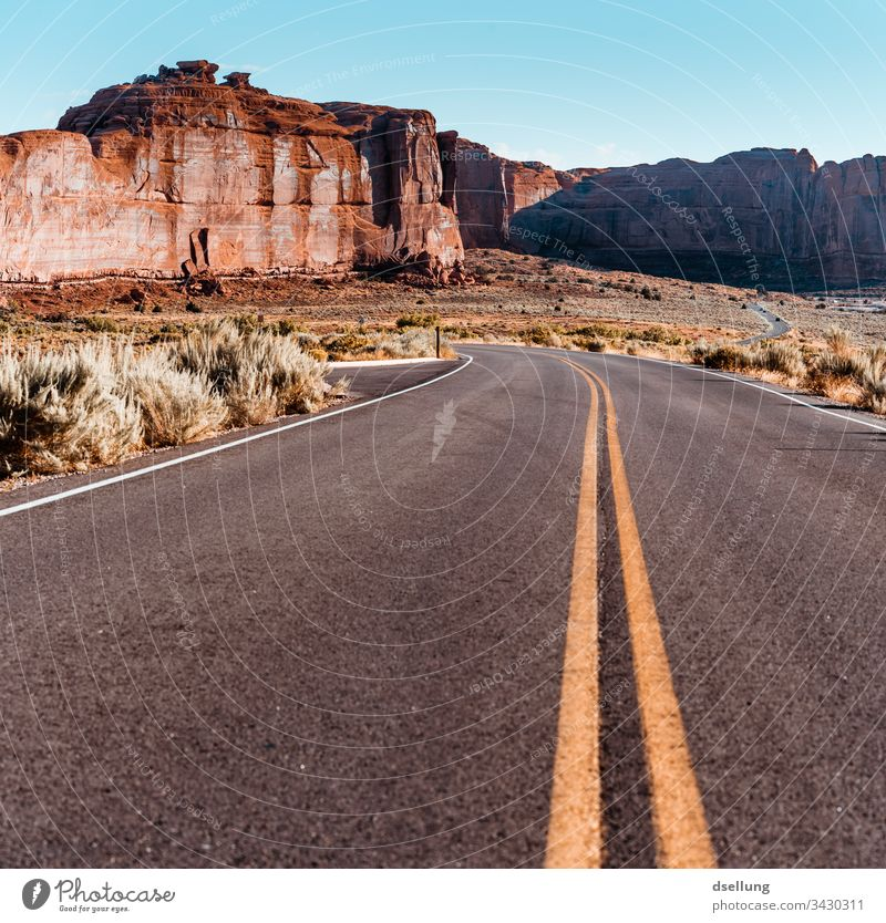 Road in Arches National Park Expedition Climate change Utah Formation Arched bridge Brilliant Bright West Warmth Vacation destination Wide angle Drought Day