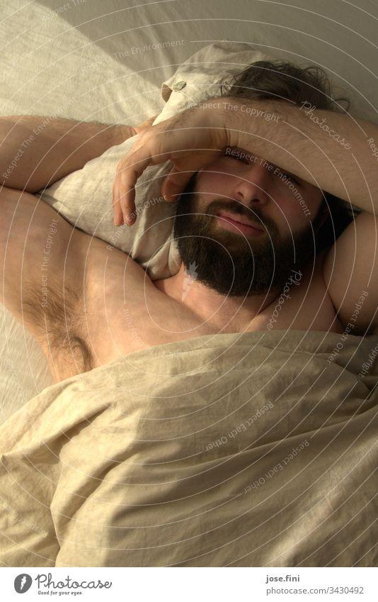 The Beardbearer Young man Lips Facial hair schnauzer Masculine Man Morning Lie Sunlight warm Bed sleep late University & College student Beard growth