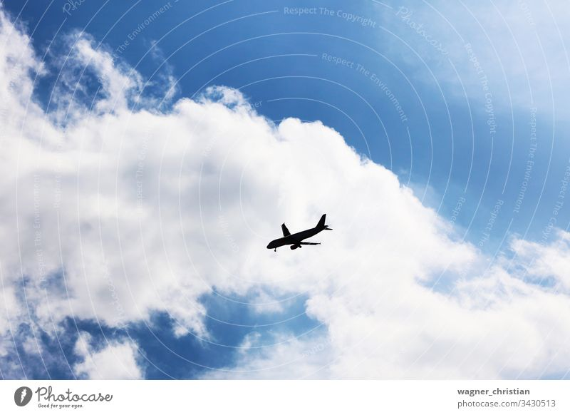 Approaching Airplane Silhouette airplane silhouette silouette approaching landing crisis flight transportation business sky background clouds aeroplane aircraft