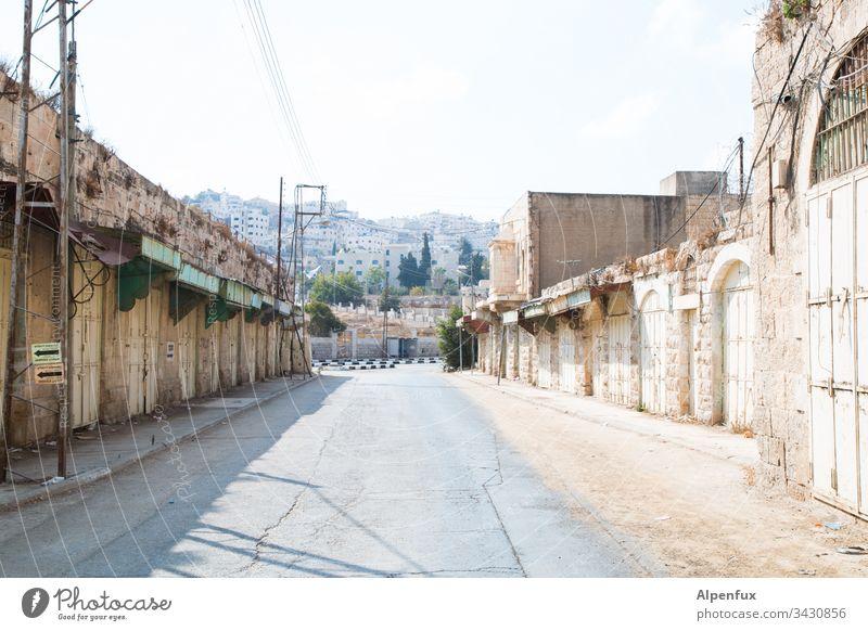 Empty Hebron void empty city empty street Deserted Exterior shot Day forsake sb./sth. Building Gray Colour photo Street deserted town dangerous city Town