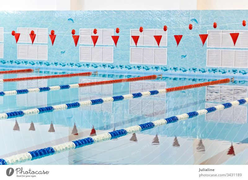 Empty swimming pool water blue wet glare sport no one nobody empty red flag interior inside