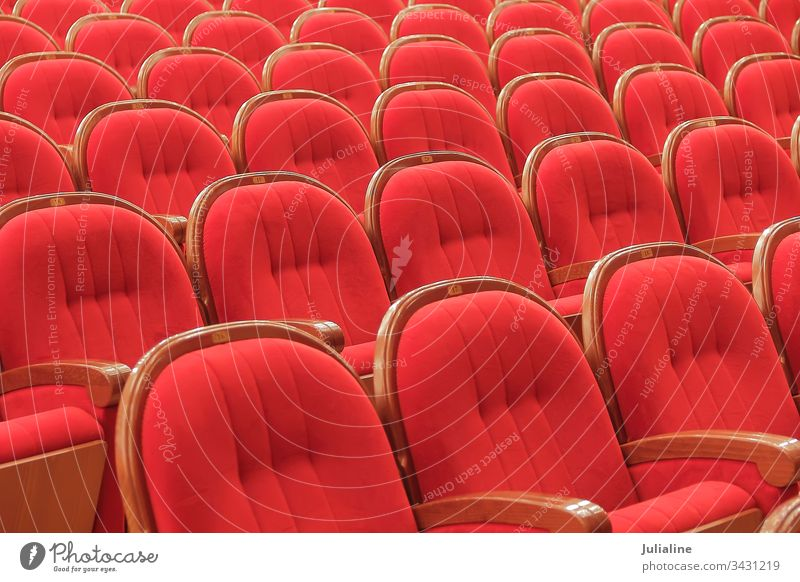 Background of red theatrical red chairs theater theatre interior seat empty arts performance nobody row stage auditorium indoors armrest velvet background