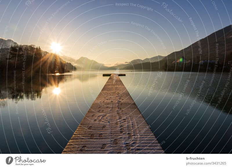 Small mountain lake with wooden jetty Lake Footbridge wooden walkway Austria Salzkammergut Morning Moody sunbathe Sunrise reflection tranquillity Calm mountains