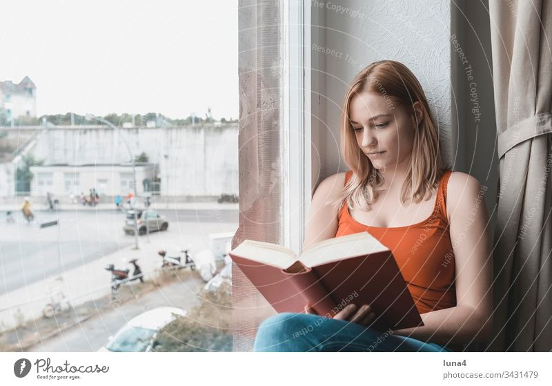 young woman reading book at window Woman Book Reading Study Window study Dreamily room Education melancholically Meditative Smiling sensual To enjoy at home