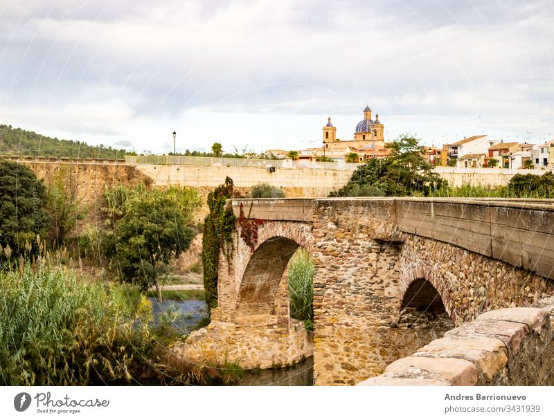 Old stone bridge rock landscape view travel scenic blue sky outdoors arch architecture summer water old stream place topography mountain leaf wet natural stones
