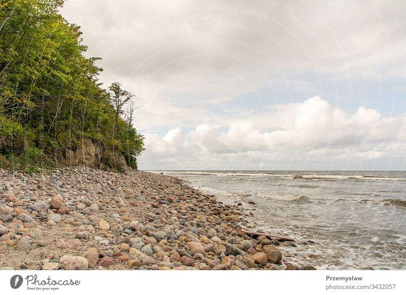 Stones on the beach in Jastrzebia Gora (Poland) baltic sea poland travel tourism jastrzebia gora horizontal landscape stones water waves day light bright