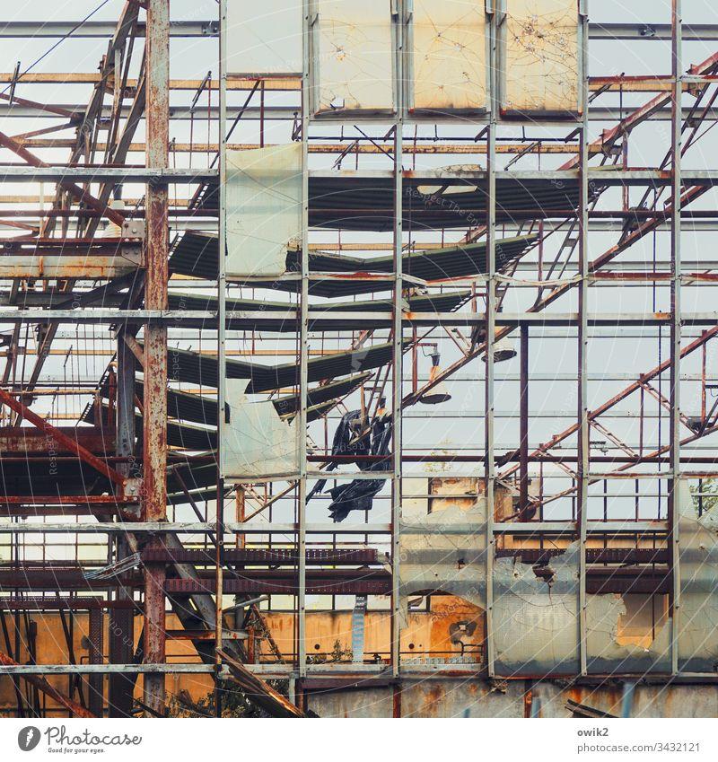 Transparent outline Grating dilapidated Old Framework Metal Deserted Colour photo Exterior shot Wall (building) Structures and shapes Decline Facade Destruction
