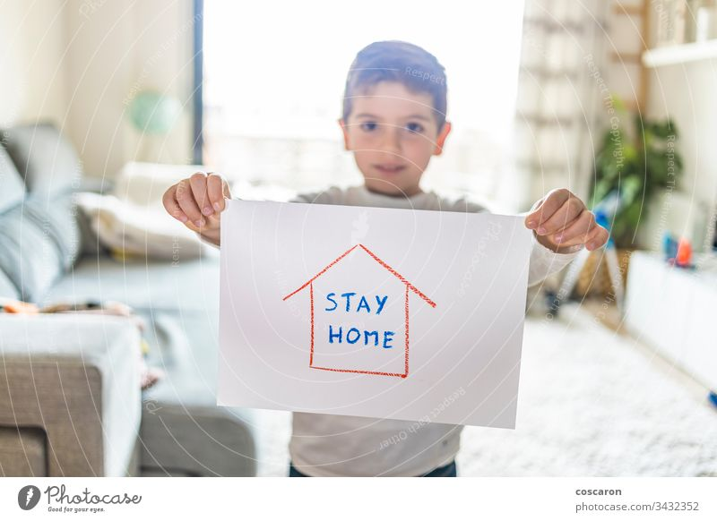 Little kid with Stay Home draw. Coronavirus concept advertisement advisory avoid background banner child childhood children corona coronavirus