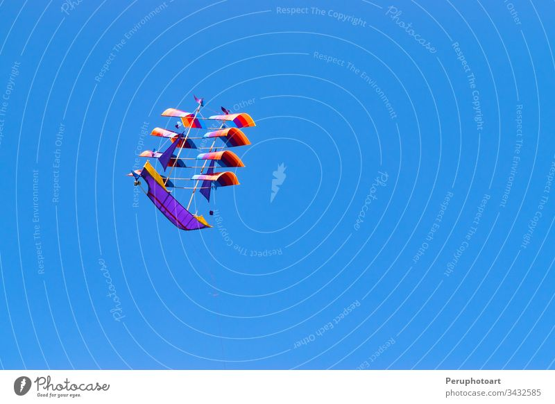 Traditional boat-shaped kite in the skies of Bali - Indonesia. bali ship sky summer blue sail sport asia beautiful vessel holiday wind tradition ocean toy