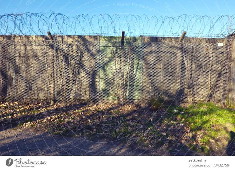 wall on the outside Deserted Copy Space Wall (barrier) Border Barbed wire foreclosure Real estate Fence Exclusion demarcation NATO wire Backup Collateralization
