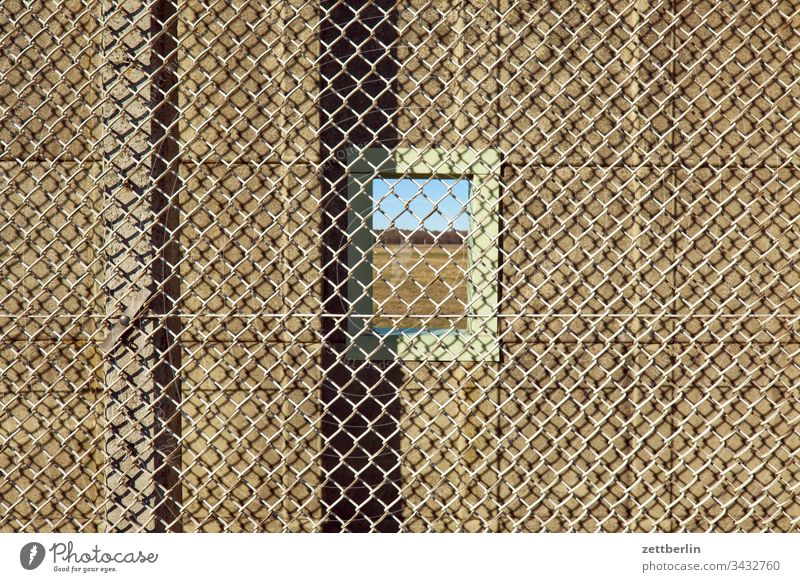 Windows in the wall on the outside Deserted Copy Space Wall (barrier) Border Barbed wire foreclosure Real estate Fence Exclusion demarcation NATO wire Backup
