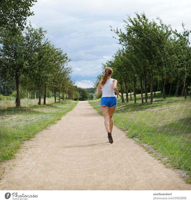 young woman jogging alone Jogging Running Woman Girl Jogger Sports Nature Sportswear Fitness Healthy Park youthful person Caucasian Lifestyle Outdoors