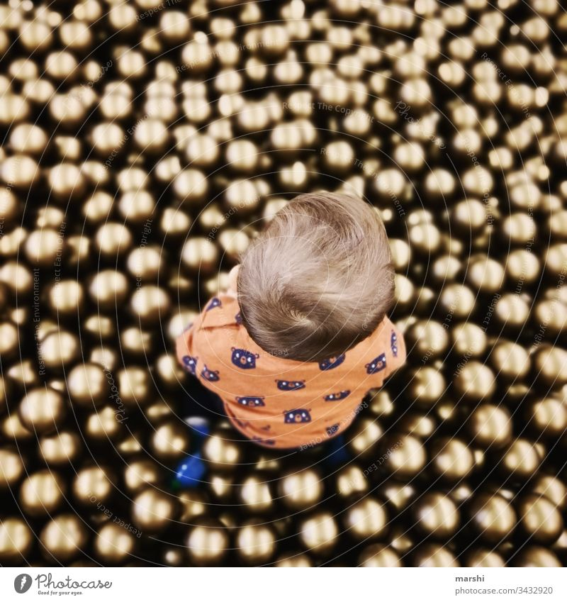 Ball paradise Child Boy (child) Playing game balls ball pool cute Infancy from on high Round Joy human free time Playground fortunate Colour photo Son Mother