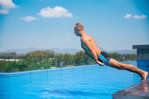 Unemotional funny man falling into swimming pool. Summer vacation action active activity adult blue boring crazy crisis despair exhausting fatigue frustrated
