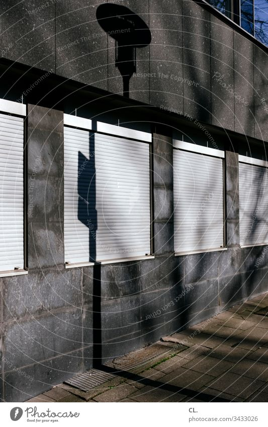 windows with closed roller shutter Architecture architectural photography Part of a building Building Facade Light Shadow Window Exterior shot Colour photo