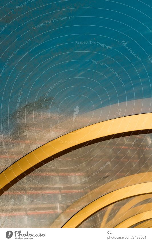 at the bus stop Abstract Swing Sky Bus stop Dirty Building Yellow Arch Slice High-rise Round Architecture Geometry Detail Structures and shapes Deserted