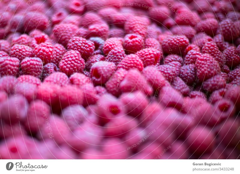 Fresh raspberries on the market fresh food organic background juicy raspberry diet ripe freshness red vegetarian healthy nutrition natural closeup nature fruit