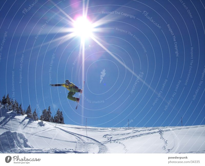 Sun Winter Snow Style Sports Jump Action Tall Posture Cloudless sky Brave Austria Blue sky Slope Snowboard Winter vacation