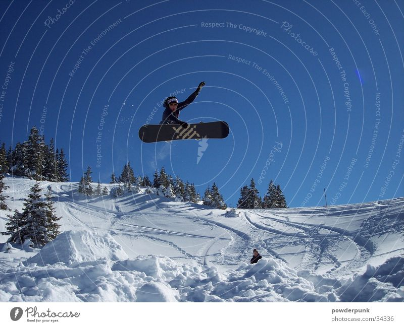 Sun Winter Snow Sports Flying Jump Action Tall Beautiful weather Touch Posture Cloudless sky Brave Facial expression Blue sky Snowboard