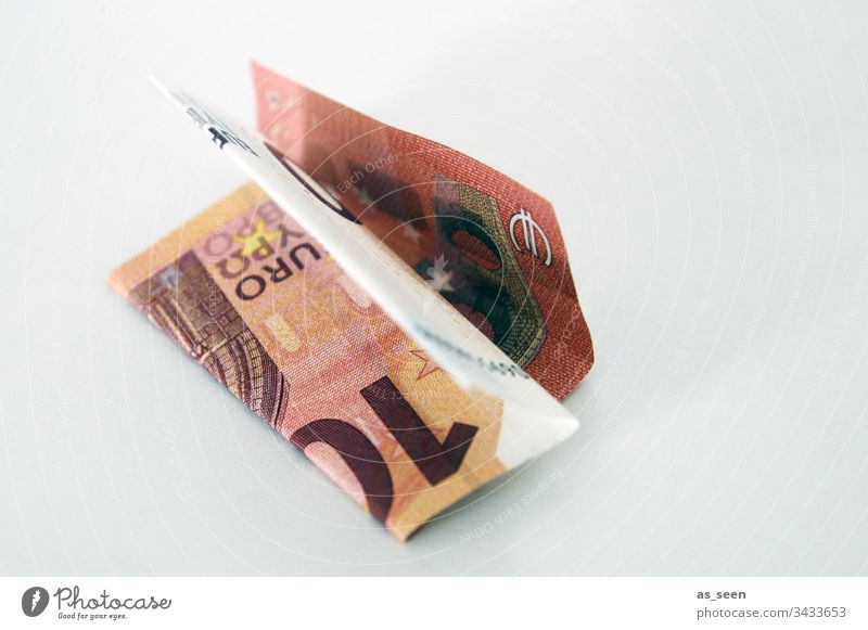 Ten Euro banknote Money Bank note Save arm Rich finance Folded 10 Lie Little Financial Industry Paying Colour photo Shopping Financial institution Income