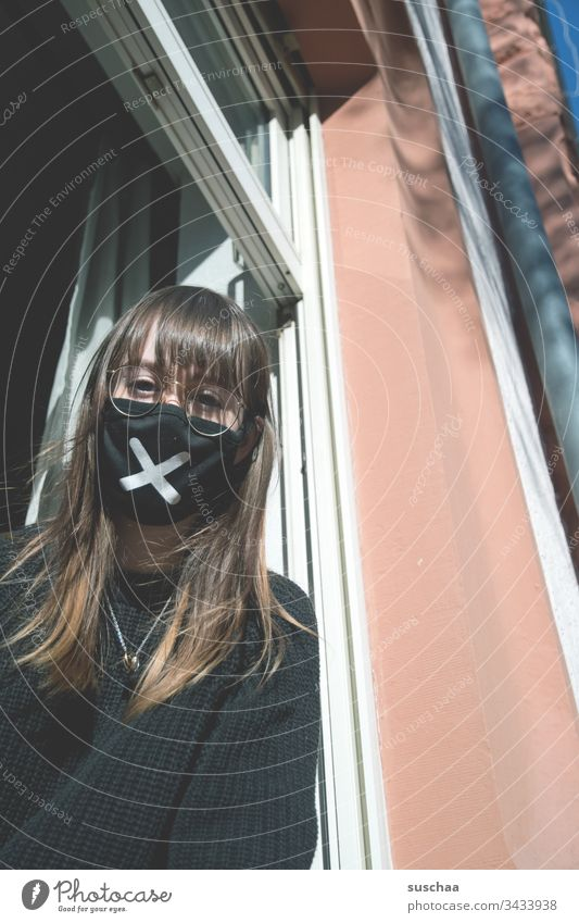 teenager with face mask at the window | corona thoughts Youth (Young adults) Young woman at home home office Eyeglasses stay at home Crisis corona crisis
