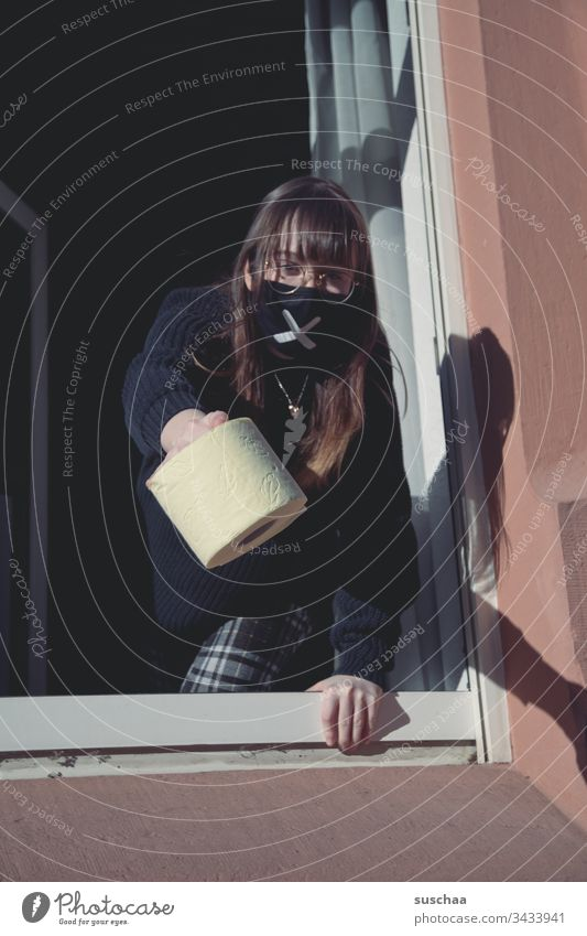 teenager with mouthguard at the window with a roll of toilet paper | corona thoughts Youth (Young adults) Young woman at home home office Eyeglasses