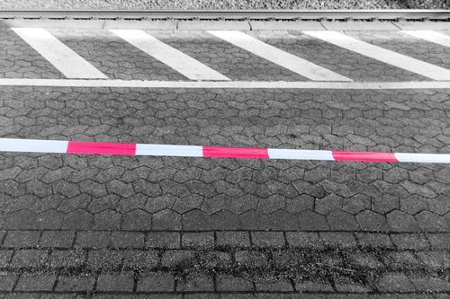 Barrier banding at the platform Stop (public transport) Train station Platform barrier tape flutterband Railroad tracks Construction site Red White nobody