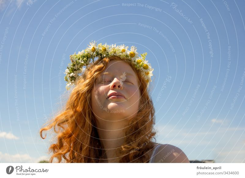Red-haired young woman with wreath of flowers Flower wreath blossoms Happy Curl Margariths portrait Landscape format Contentment Closed eyes Sky Young woman
