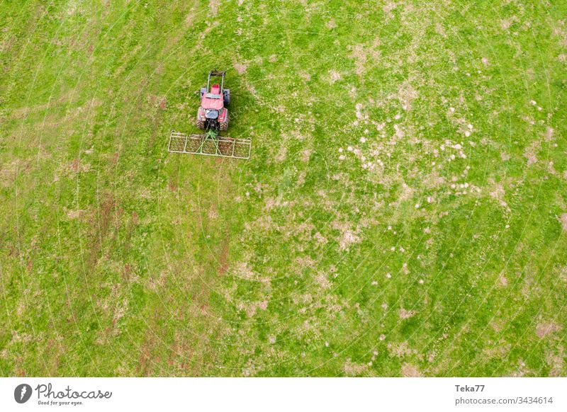 tractor on a meadow from above #2 farming tractor agriculture agricultural field grass modern modern agriculture modern machine farming machine farming truck
