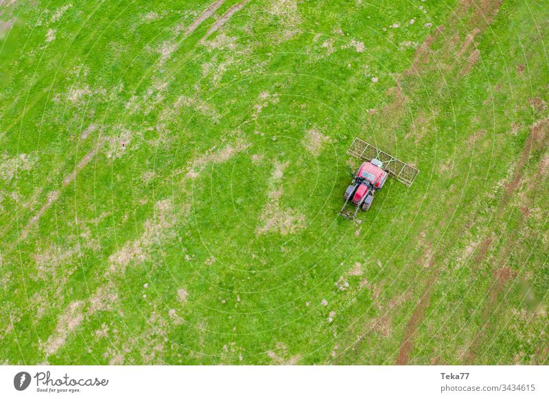 tractor on a meadow from above #1 farming tractor agriculture agricultural field grass modern modern agriculture modern machine farming machine farming truck