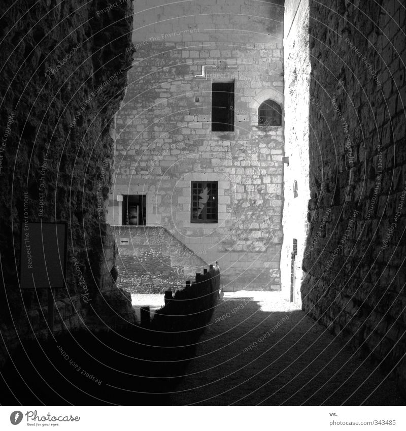 Sunny dungeon. Old town Castle Ruin Manmade structures Architecture Wall (barrier) Wall (building) Facade Tourist Attraction Monument Hope Black & white photo
