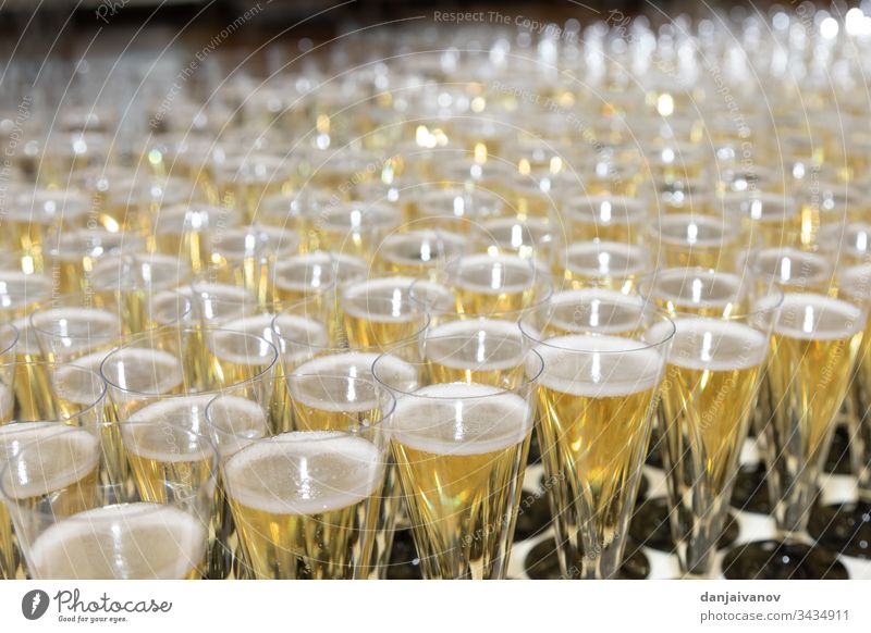 Many glasses of champagne on the table alcohol anniversary background beverage celebration closeup cocktail crystal drink event festive glassware group liquid