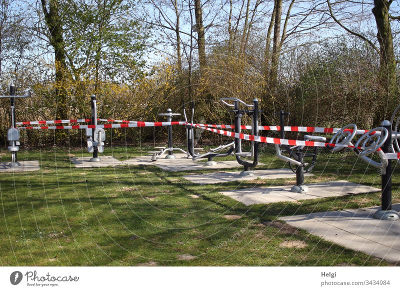 Sports equipment in the park is shut down and wrapped in barrier tape to prevent infection with the corona virus Park Fitness Barred Sports Training