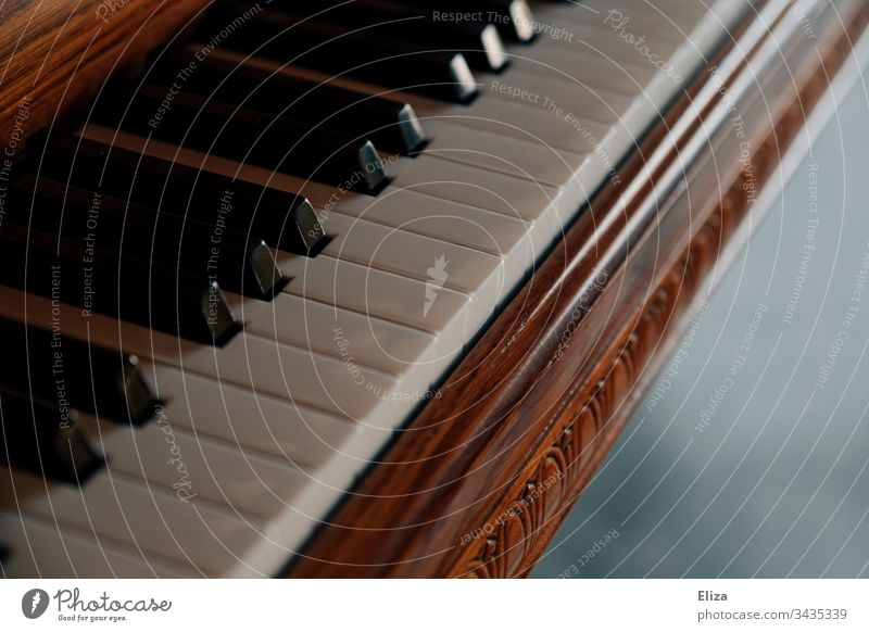 Close-up of a beautiful wooden piano and its keys Piano Wood fumble piano grand Playing the piano musical pretty ornaments Music Musical instrument Detail