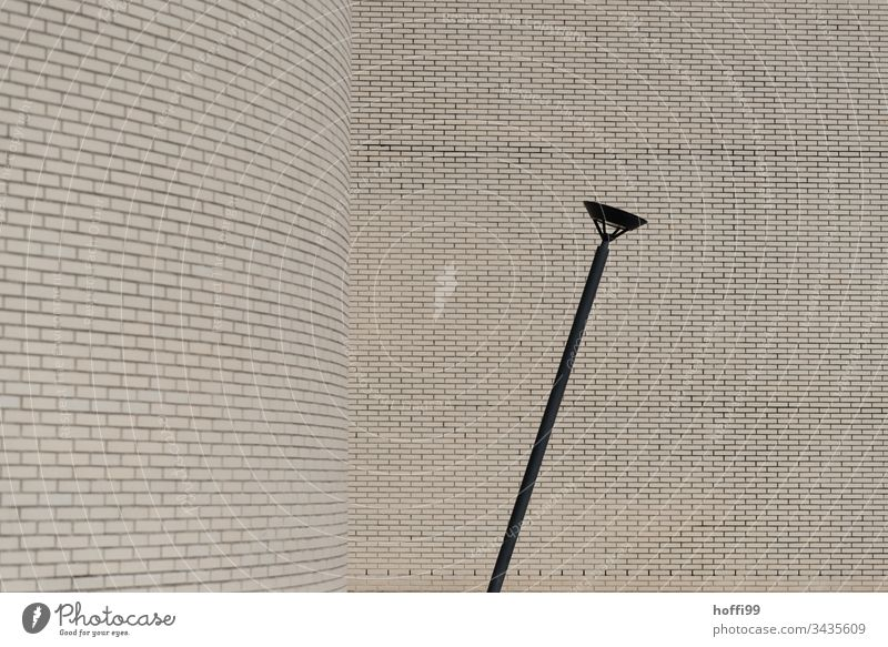 Street lamp with brick wall Wall (building) Architecture minimalism Tilt Destruction Decline Lamp post Lantern Facade Wall (barrier) Building Esthetic Line