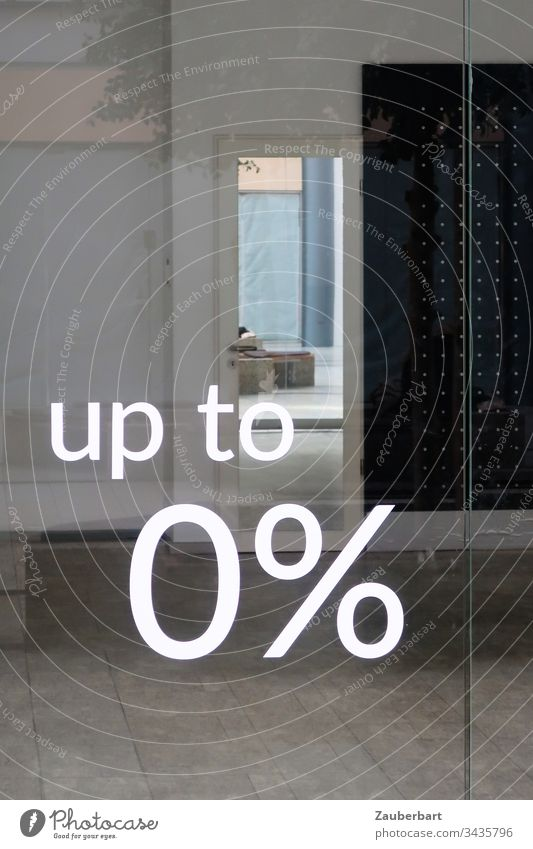 View into an empty shop through a glass pane with lettering 0% Load Empty nil Percent crash Crisis Economic crisis Gray Window tiles writing Characters Discount