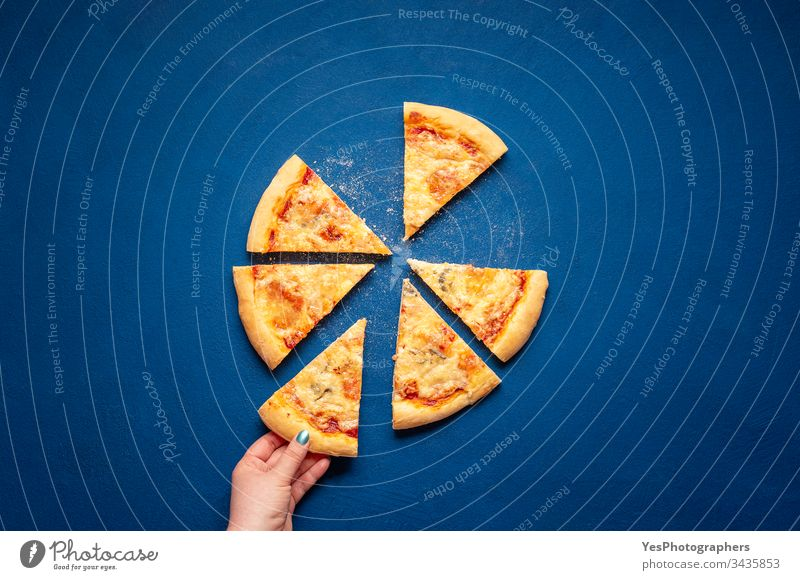 Sliced four cheese pizza. Taking a pizza slice 4 cheese pizza Italian above view carbohydrates carbs classic blue crust cuisine dinner eating european famous