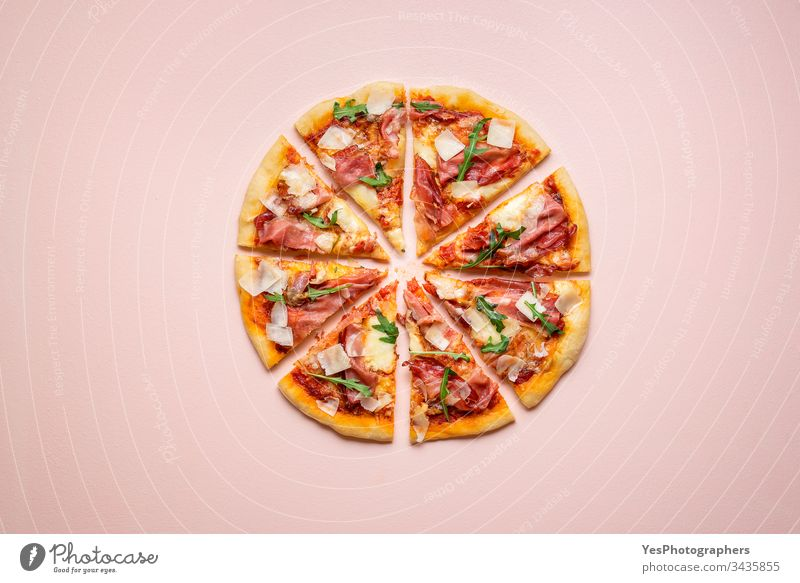 Sliced pizza prosciutto with arugula and parmesan. Italian ham pizza carbs cheese and ham cuisine dinner european famous fast food finger food flat lay homemade