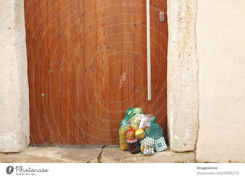 Delivery purchase during quarantine. Shopping bag with groceries, food at the front door, neighbourhood support - concept for quarantine period due to coronavirus infection Covid-19