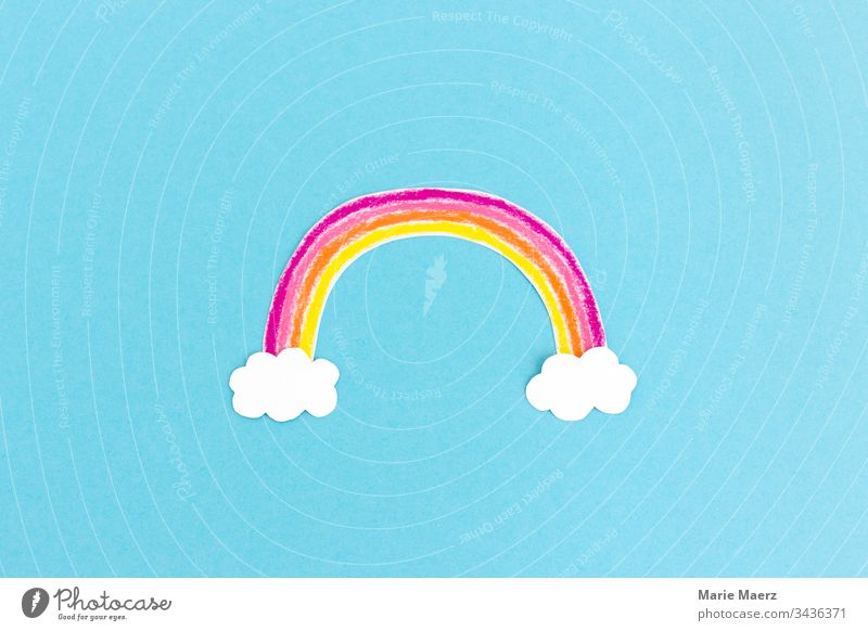Colourful rainbow painted from paper with white clouds on light blue background Rainbow Child Creativity Painting (action, artwork) Handicraft Image Painted