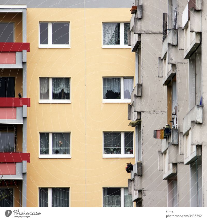 Neighborhood, presumably clairaudient House (Residential Structure) Window Curtain Gloomy Gray Yellow Red Balcony Narrow neighbourhood Near High-rise dwell