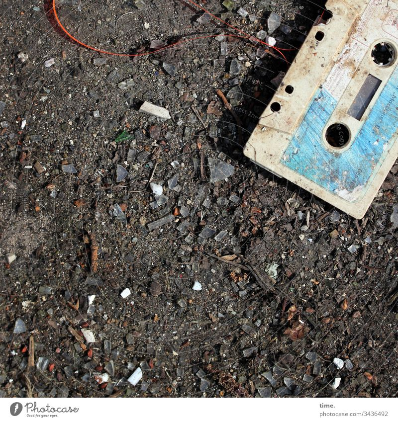cute little dirty audio tape Plastic Shadow Sunlight Imprint filth Dirty frowzy detail lines Surface Trashy Broken sandy tar soil cassette audio cassette