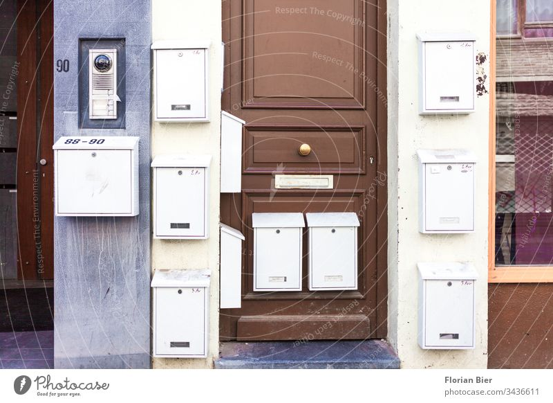 Externally mounted mailboxes on a residential building with entrance door Mailbox Mailbox slot Apartment Building Front door Letter (Mail)