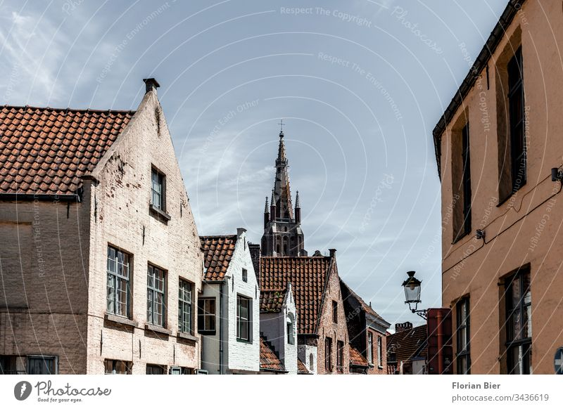 Residential buildings in the old town of Bruges with view of the Liebfrauenkirche House (Residential Structure) Window Facade Building style Window pane