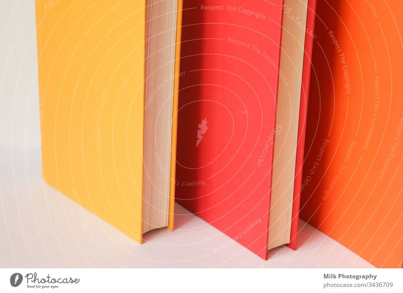 Colourful books standing on a white background vertical nobody colour color photo image styled stock copyspace space for text copy space neutral wall dictionary
