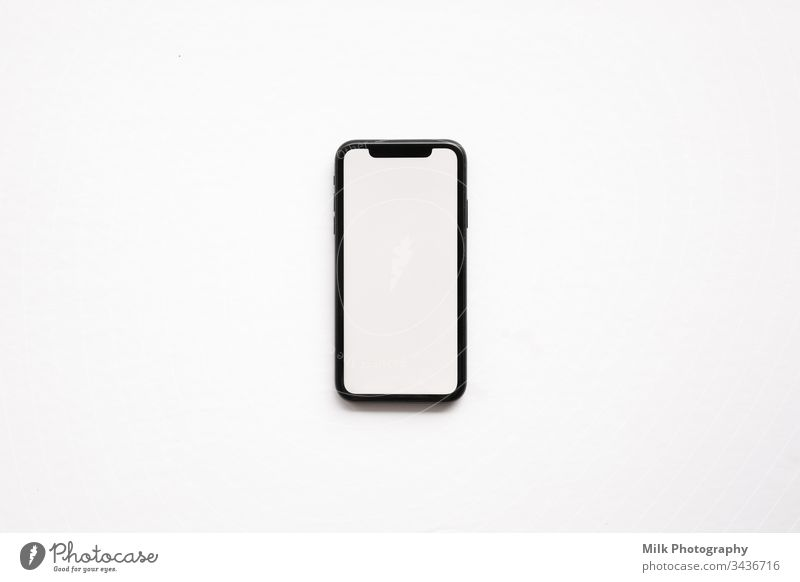 A smartphone isolated on a white background Internet PDA Cellphone Neutral Background Studio shot Transmit Screen Display Information Spark replace Connect
